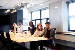 Group of executives working in conference room Stock Photos