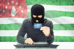 Concept of cyber crime with flag on background - Abkhazia - stock photo