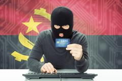 Cybercrime concept with flag on background - Angola - stock photo
