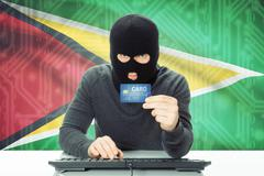 Cybercrime concept with flag on background - Guyana - stock photo