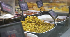 Taking picture of olives in the shop Stock Footage