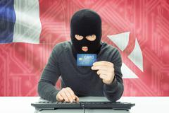 Cybercrime concept with flag on background - Wallis and Futuna - stock photo