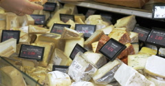 Great assortment of cheese in the shop - stock footage