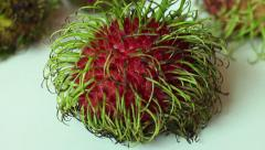 ASIAN RAMBUTAN FRUIT: CU Camera dolly over Rambutan group Stock Footage