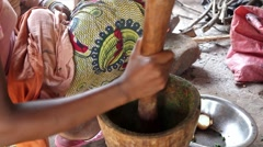 African woman smashing pepper with pistle and mortar Guinea Bisseau Stock Footage