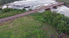 Aerial African bridge and road, Corubal river and Saltinho Stock Footage