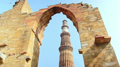 Qutab Minar in New Delhi framed through arches of ruins Stock Footage
