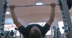 Strong man working on bench press Stock Footage