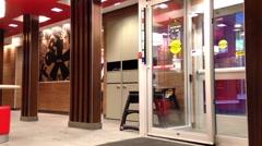 The door entrance of mcdonalds fast food restaurant Stock Footage
