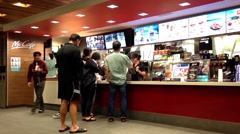 People ordering food at mcdonalds check out counter - stock footage