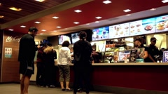 People ordering food at mcdonalds check out counter Stock Footage
