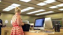 Motion of people buying new mac book Apple store Stock Footage