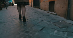 Woman in a hurry running along the street - stock footage