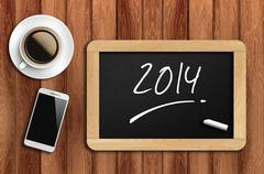 coffee, phone  and chalkboard with  word 2014 - stock photo