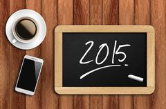coffee, phone  and chalkboard with word 2015 - stock photo