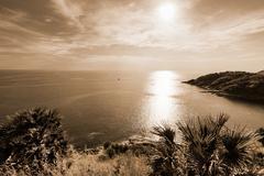 Stock Photo of High angle view island and sea at Laem Phromthep on sepia colour tone