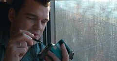 Online shopping with phone in the train Stock Footage