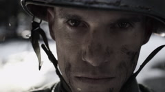 Close up of Soldier with debris coming down Stock Footage