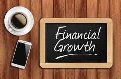 coffee, phone  and chalkboard with  word financial growth - stock photo