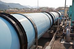 Large water pipe in a sewage treatment plant Stock Photos