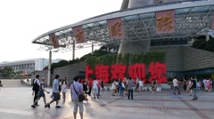 Taverllers at Shanghai Oriental Pearl Tower,Red word means Welcome to Shanghai - stock footage