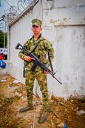 Colombian army soldier carrying an assault rifle AK 47 during Colombia's most - stock photo