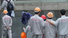 Chinese construction worker walking in the Shanghai street - stock footage