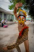 Performer dressed in jaguar skin costume and face paint part of the El Tigrillo Stock Photos