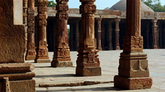 Female tourist walks between ancient columns Stock Footage