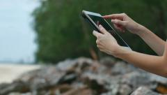 Touch Screen Tablet On Rock At Beach Stock Footage