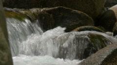 Flowing and splashing water closeup Stock Footage