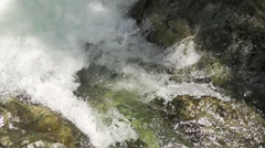 Raging river with a small waterfall over rocks in super slow motion Stock Footage