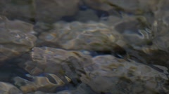 Flowing and splashing water closeup Stock Footage
