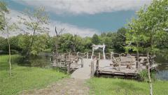 Outdoor altar for wedding by the river on a wooden raft. Steadicam Stock Footage