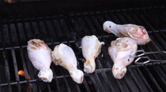 Raw chicken on the bbq Stock Footage