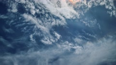 White clouds moving high over blue sky background, sun shining. 4K UHD Timelapse - stock footage