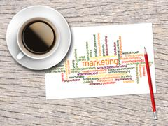 Coffee, Pencil And A Note Contain Word Clouds Of Marketing And Its Related Wo Stock Illustration