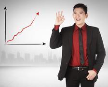 Asian business man give hand gesture OK Stock Photos