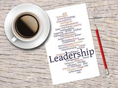Coffee, Pencil And A Note Contain Word Clouds Of Leadership And Its Related W Stock Illustration
