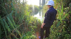 Woman fishing at pond in the morning Stock Footage