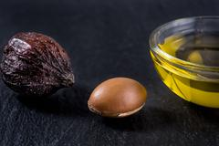 Argan oil and fruits - stock photo