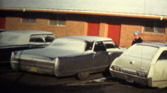 (8mm Vintage) 1974 Motel Living Homeless Cleaning Car For Money Stock Footage