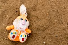Child's discarded fluffy toy rabbit Stock Photos
