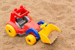 Child's Bright Plastic Digger Toy - stock photo
