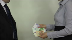 Man pay euro cash money banknotes for woman and handshake. 4K Stock Footage