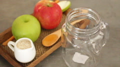 Apple with oats and honey smoothie in small jar HD Stock Footage