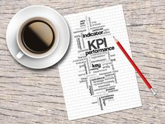 Coffee, Pencil And A Note Contain Word Clouds Of KPI And Its Related Words Stock Illustration