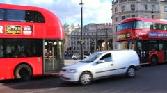 Typical street view with traditional double-decker red bus in Trafalgar Square Stock Footage