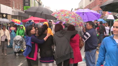 Rain umbrellas and large crowds at the Toronto gay pride festival Stock Footage
