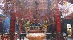 Burning hanging incense coils at Quang Duc Pagoda temple in Can Tho, Vietnam. Stock Footage